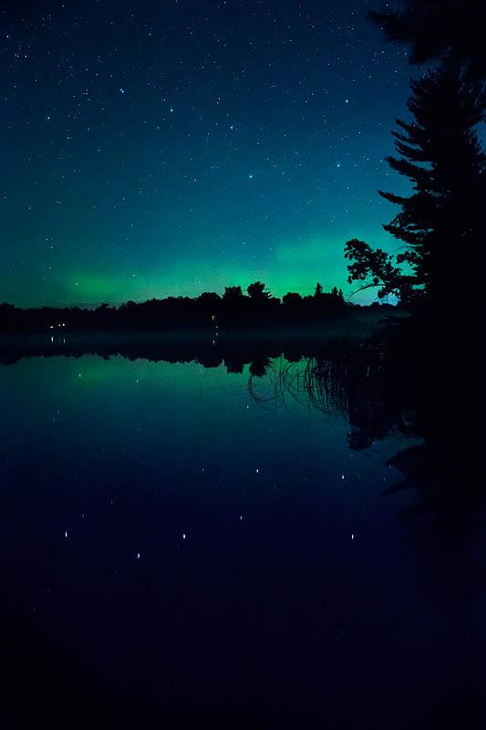 surprise big dipper aurora borealis reflection in minnesota lake