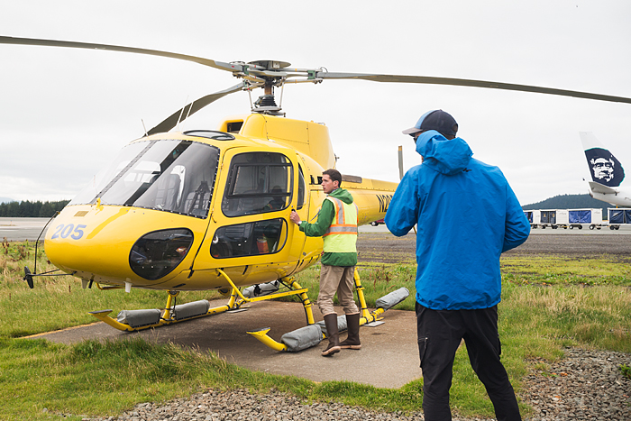 Pilot preparing helicopter for take off, Juneau, Alaska